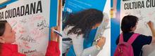 Compromiso de Cultura firma de estudiantes, profesores, TransMilenio